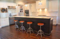 Vermont Danby tops, espresso island, hardwood floors, retro bar stools, white cabinets.
