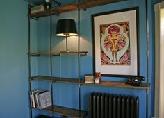 Building DIY Plumbing Pipe Shelves in My Dining Room Cord Hider, Plumbing Pipe Shelves, Black Lamps, Open Shelving, Industrial Shelving, Blue Walls, Wall Shelves, Apartment Therapy, Living Spaces