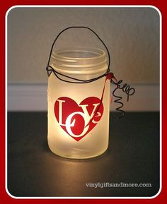Mason Jar, spray painted with frosted spray paint, with a love vinyl sticker on it. Around the lid is a wire hanger and inside is a tea light. It is a perfect gift. Simple, easy, and affordable! Mason Jar Gifts, Mason Jar Diy, Vinyl Crafts, Jar Crafts, Mason Jar Projects, Diy Projects, Jar Design, Mason Jar Flowers, Jar Lanterns