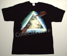 STEVE HACKETT Guitar Noir CUSTOM ART UNIQUE T-SHIRT Genesis  Each T-shirt is individually hand-painted, a true and unique work of art indeed!  To order this, or design your own custom T-shirt, please contact us at info@collectorware.com, or visit  http://www.collectorware.com/tees-genesis_andrelated.htm