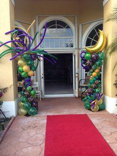 Mardi Gras entrance. Balloon columns with red carpet runner. www.dreamarkevents.com