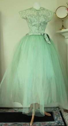 An elegant 1950's Minty Green Lace Tulle Gown...  Looks like something you'd wear to Grace Kelly's wedding. :)