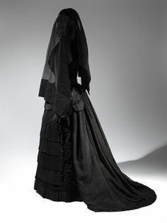 Mourning Ensemble, 1870-1872 Black silk crape, black mousseline The Metropolitan Museum of Art, Brooklyn Museum Costume Collection at The Metropolitan Museum of Art, Gift of the Brooklyn Museum, 2009; Gift of Martha Woodward Weber, 1930 (2009.300.633a, b) Veil, ca. 1875