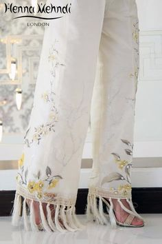Ivory raw silk boot cut trousers with lemon sequinned embroidery and embellishment with tassel accessories. Please note these are trousers only. Please note del Indian Fashion, Women's Fashion, Desi Clothes, Tunic Pattern, Flare Pants, Indian Sarees, Kurtis, Free Delivery, Designer Dresses