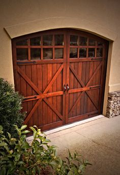 Wooden Carriage Door with Arch & Glass | Carriage Doors & Garage Doors - Augusta GA - Jack Sheppard Enterprises