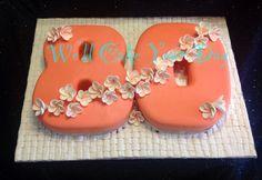 80th mud cake with choc ganache and gumpaste frangipanis Part one of 80 th birthday cake.