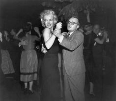 wehadfacesthen:  Marilyn Monroe dancing with Truman Capote, New York, 1955