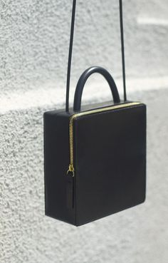 Los Angeles-based Building Block has yet again delivered a collection of bags that redefines functional pieces into an elegant minimalism. Looking back at their previous collections, the style has subtly evolved toward a more mature and luxurious directio. #bags #style #fashion Michael Kors Clutch, Michael Kors Outlet, Bag Sewing, Boxy Crop Top, Crop Tops, Fashion Accessories, Women Accessories, Jewelry Accessories, Michael Kors Designer