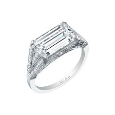 Neil Lane Emerald Cut Diamond Ring Horizontally Set in Platinum: http://www.stylemepretty.com/2016/08/02/east-west-engagement-ring-trend/