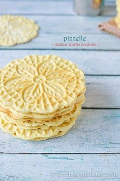 Pizelle:  Italian waffle cookies.  Oh, I really want to make these.  Aren't they pretty?  Simple ingredients.  Crisp but tender with flavors of butter and vanilla.  Now, please?!  I must find a Pizelle baker.