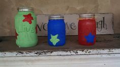 Mason jars with paint. The letters are hot glue. Simple and cheap. :) great for candles or flowers.