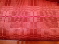 derived from: Isaac's Favorite: Weaver Rose's coverlet no. 60: p. 154: Marguerite P. Davison: A Handweaver's Pattern Book   pattern modified to make double-faced cloth: overshot-to-double weave   8/2 cotton: pink, brown, interspersed with random stripes of other colors for fun   4-shaft, 8-treadle