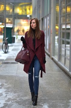 Plum is making a return this season! Barbora Ondrackova looks sophisticated and wintery in this cute plum overcoat, worn with skinny denim jeans and a matching handbag. Coat: Medicine, Turtleneck: Proenza Schouler, Jeans: Paige, Boots/Bag: Givenchy. Cute Winter Outfits.