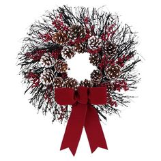 Frosted pinecone and faux berry wreath with a red ribbon accent and natural twig base.