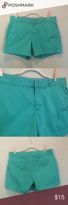 """Banana Republic Green Chino Stretch Shorts These shorts are so comfortable but I've only worn them a handful of times because they are too short for my liking. 98% cotton 2% spandex. Zip fly with hidden slide and button closure. 2 slash pockets at hips and 2 slash pockets on back (these are still sewn shut). Labeled as a size 6. Measures approx 16.5"""" across the top of the waistband. 5"""" inseam. These show minor wash wear but there are no holes or stains.  I think the color is truest in last…"""