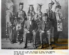 Standing L-R: Peter Ever Wind (Ojibwa), Joe Mason (Ojibwa), George High Landing (Ojibwa), Ane-ne-gwan-abe (Ojibwa), Nodin (Ojibwa), John English (Ojibwa) Sitting L-R: Paul H. Beaulieu, Judge Gibbons – 1916