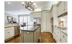 White cabinetry // stainless appliances // open to breakfast area