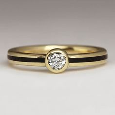 This stunning ring is made in yellow gold with a laburnum inlay and a bezel set white diamond. The slender width of the band accentuates the size of … Wood Inlay Rings, Wood Rings, The Argyle, Champagne Diamond, Contemporary Jewellery, Precious Metals, Wedding Rings, Engagement Rings, Band
