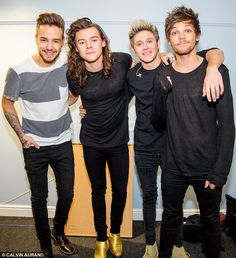 All smiles: One Direction were seen smiling backstage together before their emotional final gig on Saturday night