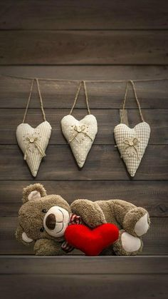 Cute hanging hearts, teddy bear with a big red heart. Love his sweet smile.