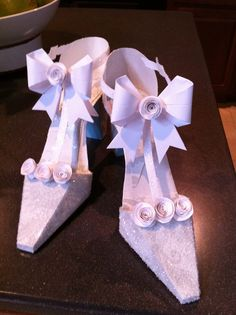 Paper shoes for the bride table.