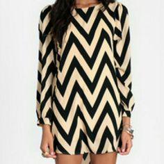 Chevron dress Black and Beige chevron dress. it says XL but runs like a Medium. I ordered it to be loose on me but it's too tight. never worn Dresses Long Sleeve