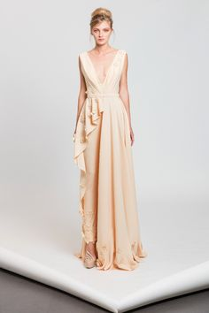 Melon jumpsuit in Moroccan crepe featuring a belted waistline, a half skirt and laser cut flowers appliques.