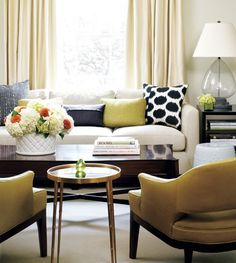cream sofa with grey and yellow accents!