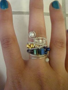 Wire wrapped rings are really popular. It's a good thing artisans are always coming up with different approaches and variations of wire wr...