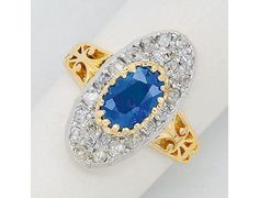 Sapphire, Diamond, Platinum and 18K Gold Ring « Dupuis Fine Jewellery Auctioneers