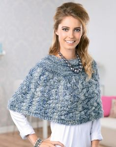 Worked with two strands of yarn together, Jan Henleys chic capelet knits up in no time and is great for laying in the chilly months. The eight-stitch twist cable pattern is subtly festive but can be worn all year.