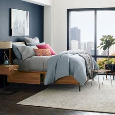 researching stylish, modern storage beds for my tiny house bedroom makeover — loving this teak bed from @westelm