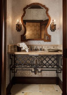 use an antique french balcony grill to form the apron on the sink. Smart. lauraleeclark - powder room