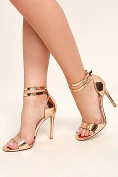 The Jacinda Rose Gold Ankle Strap Heels are all you need for a winning evening look! Patent rose gold vegan leather shines over a tapered toe strap, and sturdy heel cup with two adjustable ankle straps.