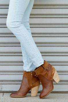 Leather and suede cognac booties with a stacked heel and cool side buckle