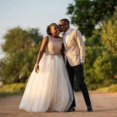 Image may contain: 1 person, standing, wedding and outdoor Setswana Traditional Dresses, African Traditional Wedding Dress, African Fashion Traditional, Traditional Wedding Attire, Traditional Weddings, African Bridal Dress, African Print Wedding Dress, African Wedding Attire, African Weddings