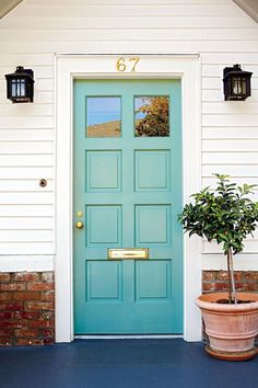 Love the light teal color of this bright and happy front door!