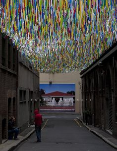 Gorgeous Rainbow Ceiling Brightens Sydney Laneway (3) - Our love & appreciation for overhead art installations continue w/ this wonderfully whimsical one by artist Nike Savvas. Chosen as one of nine contemporary artists to make us see city lanes in a new way, Savvas put up a colorful ceiling composed of thousands of long, multi-colored strands along Sydney's Bridge Lane... as the wind stirs, one can only imagine looking up and seeing the beautiful wash of colors.