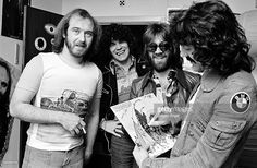Pete Agnew, Dan McCafferty, Darrell Sweet and Manny Charlton of the Scottish rock band Nazareth posing for a group shot and signing autographs in April 1975 in Copenhagen, Denmark.
