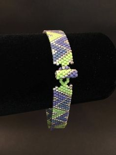 This beaded bracelet was made by weaving in one bead at a time using the peyote stitch. It is made from high quality glass Delica seed beads. These beaded bracelets have a wonderful feel to them (almost like liquid) and are very light and comfortable to wear. This bracelet is a zig zag