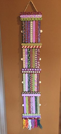 Craft sticks made into hanging art.  Each stick is painted with a base coat then a design added with paint. Took more time that I originally planned!