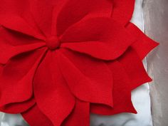 """poinsettia felt pillow. Just search Pinterest for """"felt Pillow"""" and find lots of ideas"""