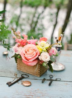 pretty peach florals in a rustic wooden box vase
