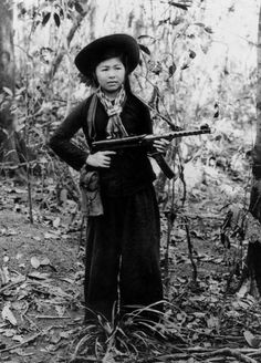 A female Viet Cong guerrilla armed with a Russian-made PPs-43 submachine gun.