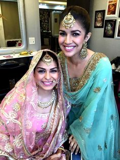 A Kodak moment between the sisters. Nimrat opted for an embellished green sharara. The bride was lovely in a pink lehenga-choli.  This image was posted on Instagram by nimratkaurfanclub