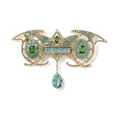 Georges Fouquet, Paris, circa 1901 Magnificent Art Nouveau brooch in 18ct yellow gold symmetrically designed with a central aquamarine panel suspending a large aquamarine drop inbetween two green tourmalines within enamelled oval forms with diamond detailing Georges Fouquet, Paris circa 1901
