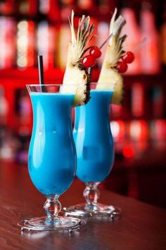 2 part Pinnacle® Coconut Vodka  1 par DeKuyper® Blue Curacao  1 part Pineapple Juice  1 part Coconut Milk  Shake with ice and strain into a hurricane glass filled with fresh ice. Garnish with Pineapple Wedge.