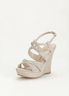 A little extra sparkle goes a long way with these crystal embellished high heel wedge sandals!  Wedge sandals are decorated with crystals along the straps.  Heel Height: 4 inches.   Available in Nude Metallic and Silver Metallic.  Available in sizes 5.5-9, 10.  Imported.