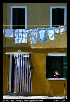 Hanging laundry and colored wall, Burano. Venice, Veneto, Italy
