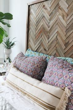 Use wood shims to create a tiled herringbone headboard to add texture and visual interest to your bedroom.
